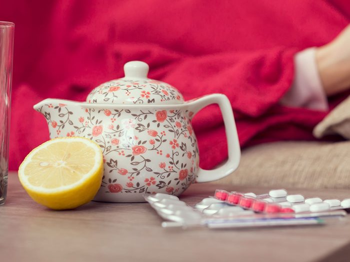 tea and pills for sick person