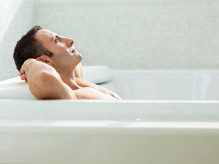 epsom salt bath - man in tub