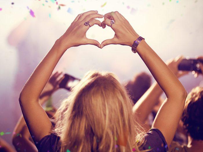 self-partnering woman at concert
