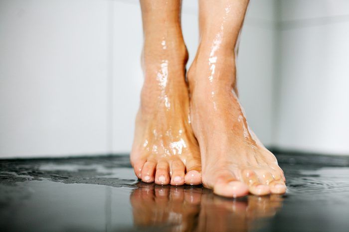 Beautiful female feet under the shower