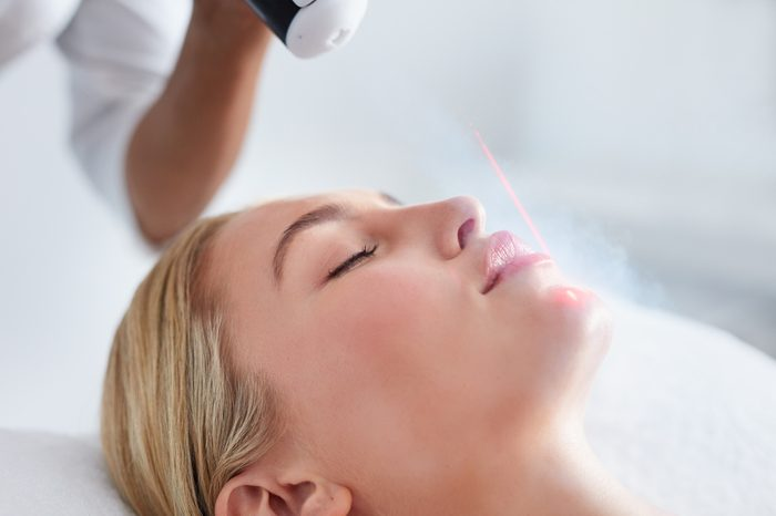 Anti-Aging Treatments   Close up of face of young woman receiving local cryotherapy. Beauty treatment using vaporized nitrogen.