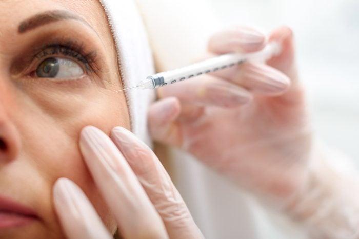 Anti-Aging Treatments   Professional beautician making botox facial injection
