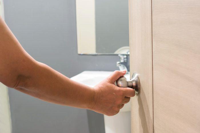 opening door to bathroom