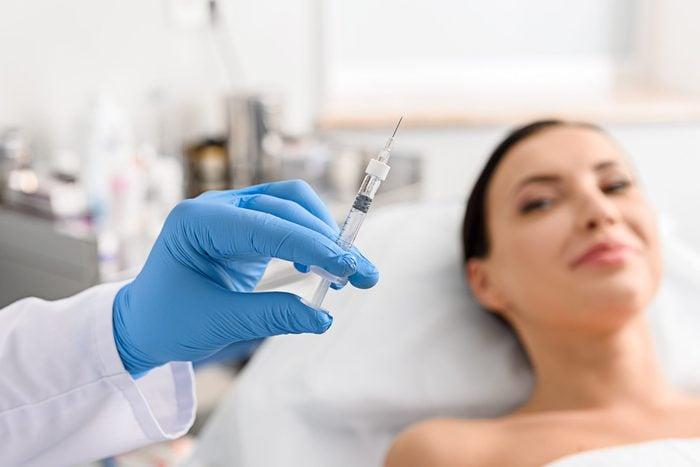 anti-aging advice | woman needle syringe botox procedure doctor