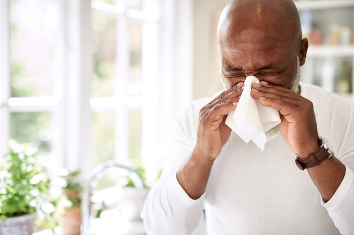 Boost your immunity naturally   man with seasonal allergies