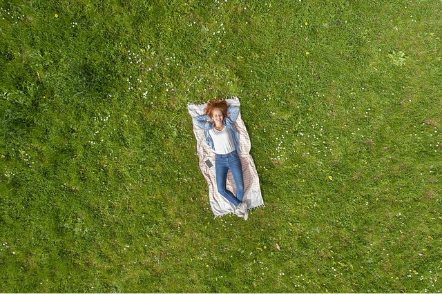 Woman-laying-on-grass