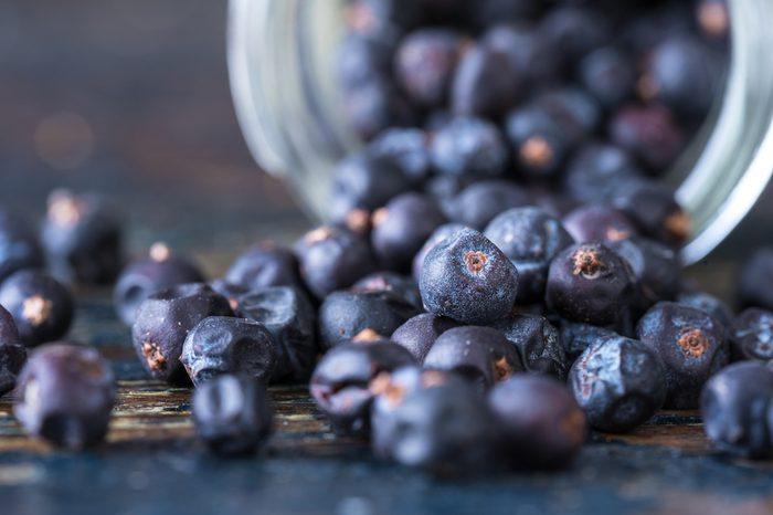 Juniper berries spilled from a spice jar