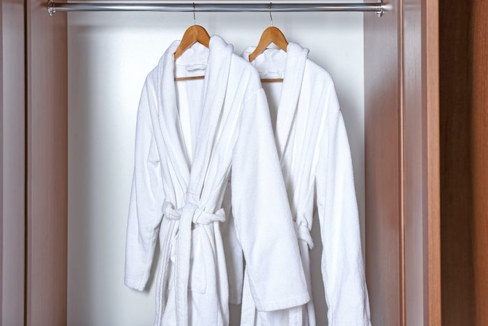 shouldn't be stored in the bathroom | Spa bathrobes hanging in wardrobe