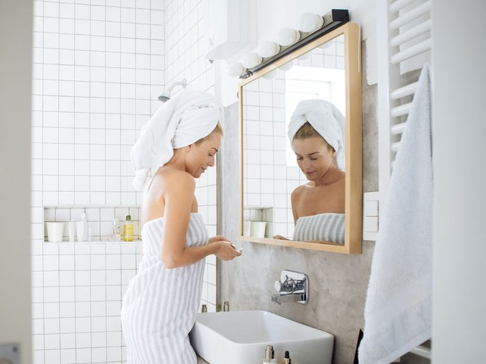 shouldn't be stored in the bathroom | woman in towel