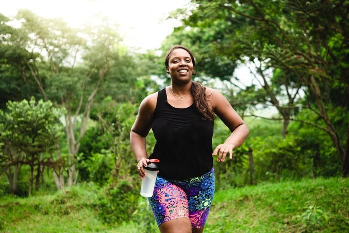 build muscle   woman walking and exercising in nature