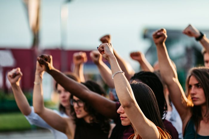 cause dehydration   protestors raising fists for racial equality