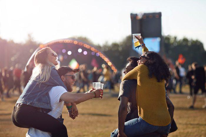 cause dehydration   friends at music festival convert