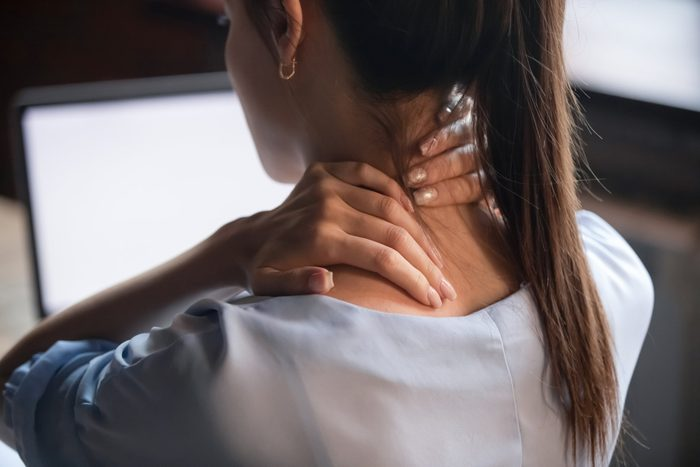 Fibromyalgia | rear view close up of woman with neck pain