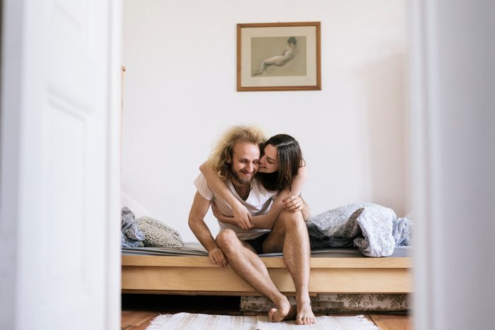 couple in bed together in the morning