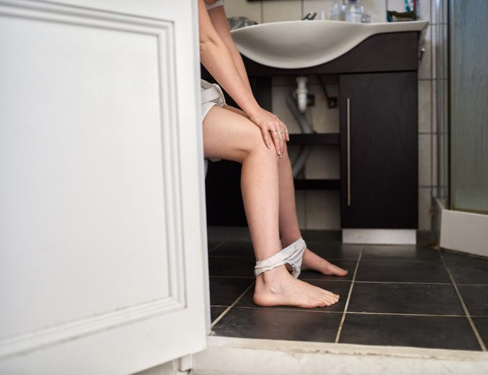Pancreatic Cancer Signs | woman on the toilet