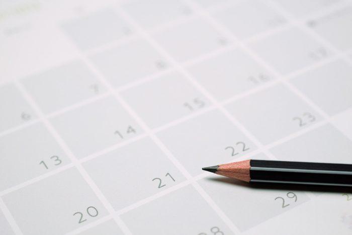 close up of pencil on calendar
