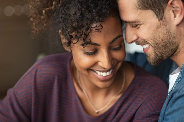 successful relationships | young romantic couple smiling together