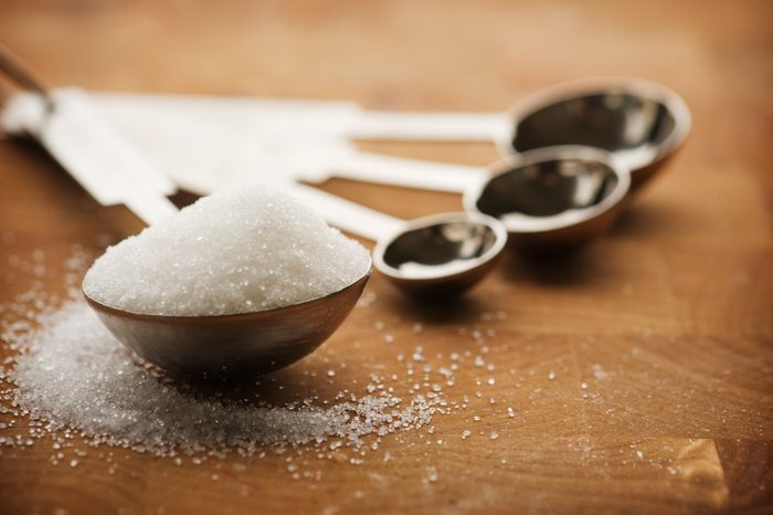 mediterranean diet | Tablespoon filled with granulated sugar