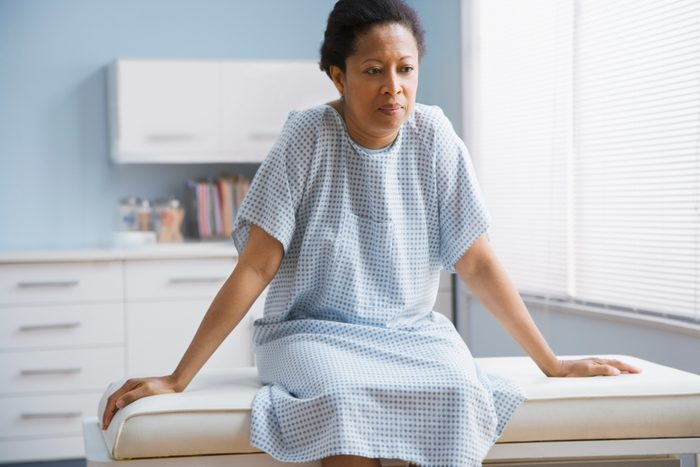 breast cancer prevention | female patient sitting on examination table in doctor's office