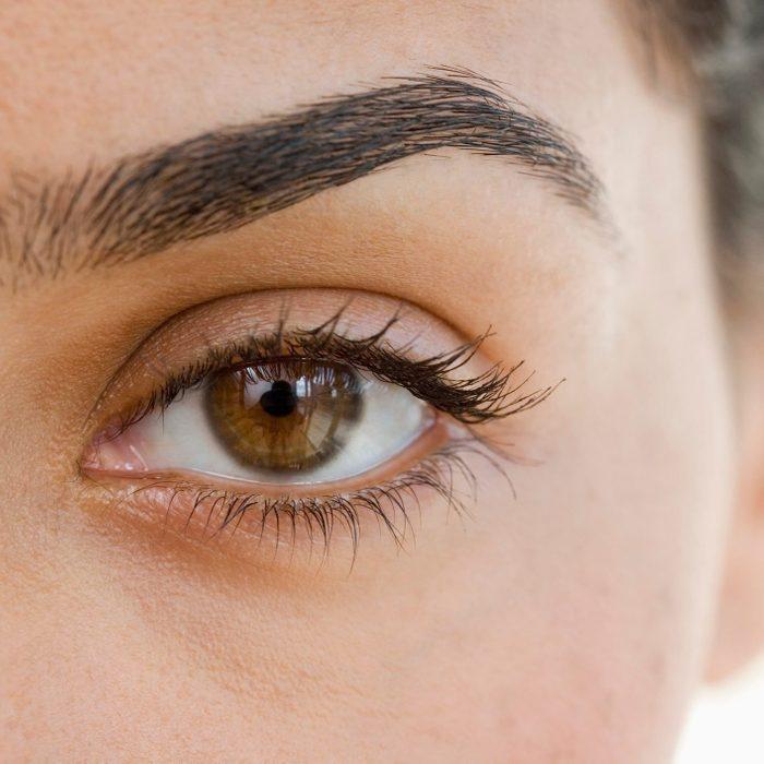 eyelid dermatitis   Extreme close up of woman's eye