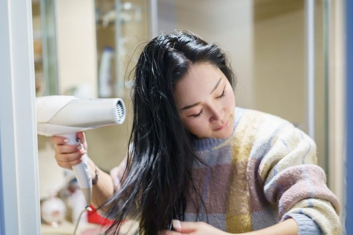 young asian female dry with blower