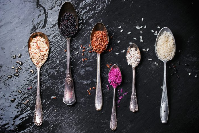 healthy rice | Directly Above Shot Of Various Rice In Spoons On Wet Slate