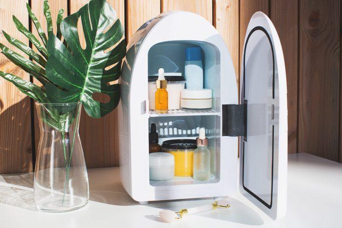 beauty fridge   image of a beauty fridge against a wooden wall   do i need a beauty fridge