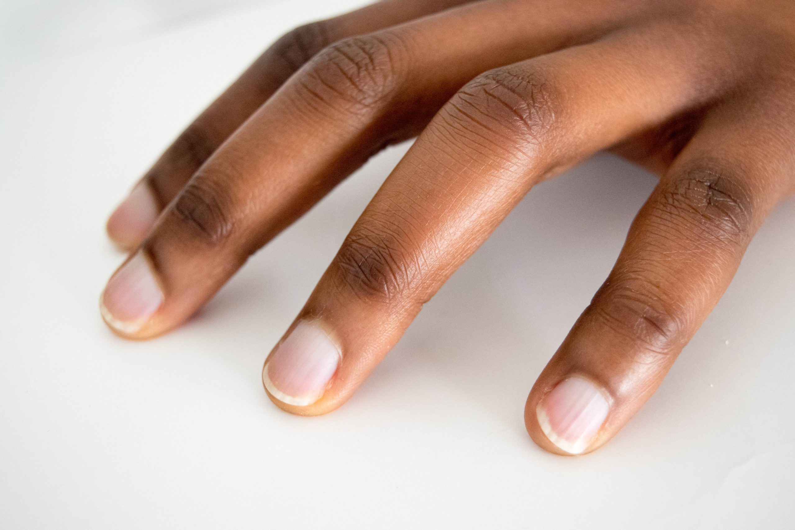 African,american,dark,brown,skin,woman,hand,with,french,manicure