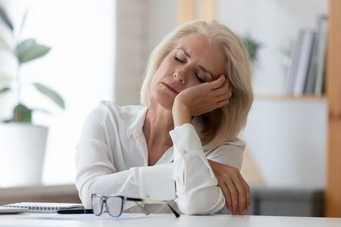 perimenopause symptoms   Exhausted,aged,woman,worker,sit,at,office,desk,fall,asleep