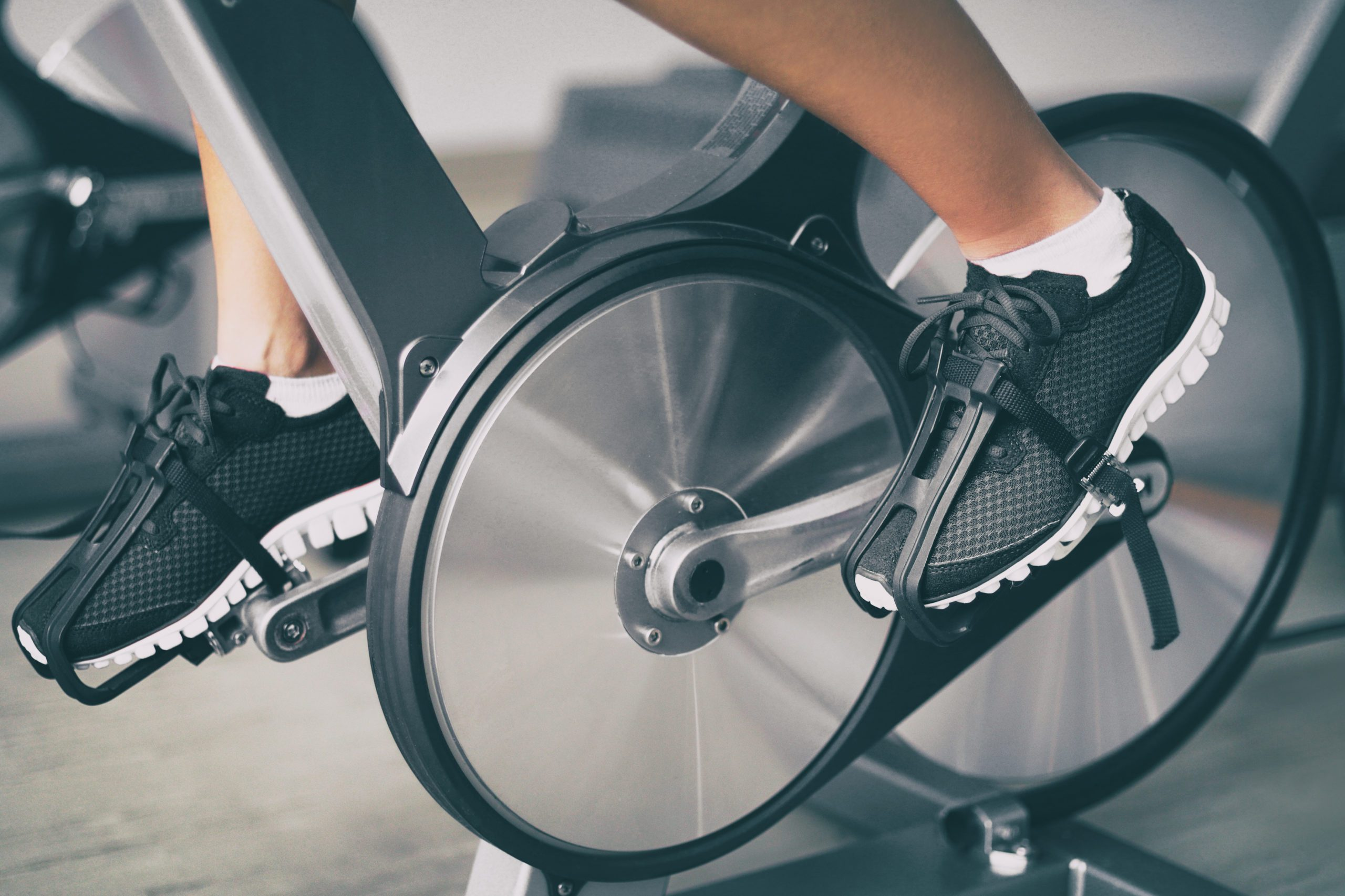 Fitness,machine,at,home,woman,biking,on,indoor,cycling,stationary