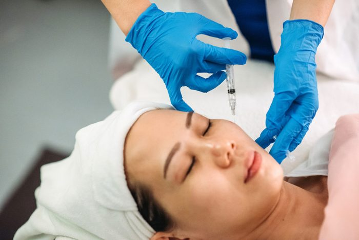 collagen injections | Asian Chinese Female Receiving Injection On The Face At Facial Beauty Salon