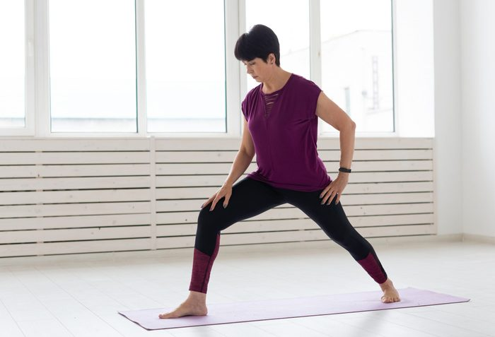calf stretches | Yoga,,people,concept, ,a,middle Aged,woman,doing,a,yoga