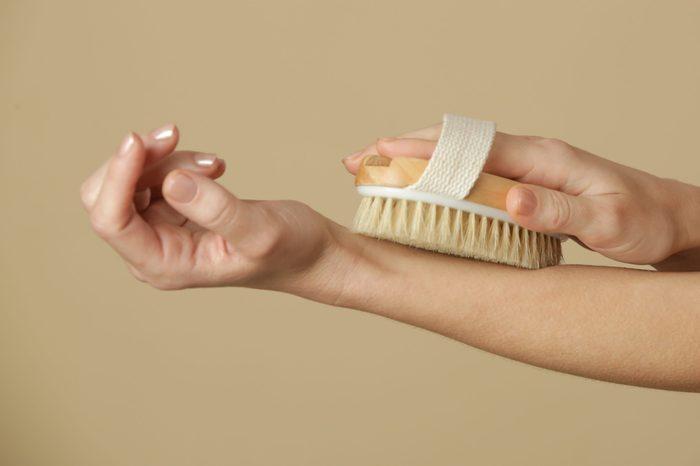 dry brushing   Dry,body,brush,,woman,dry,brushing,body,to,reduce,cellulite,