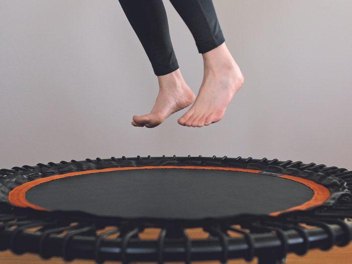 rebounder trampoline exercise   close up of feet on a rebounder