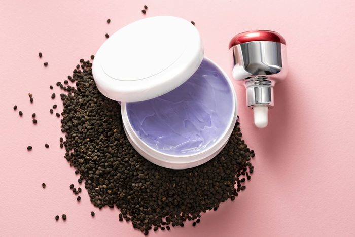 Babchi Dry Raw Seeds Psoralea Corylifolia On Pink Surface With Various Kinds Of Cosmetic Products Bakuchiol Cosmetics Concept