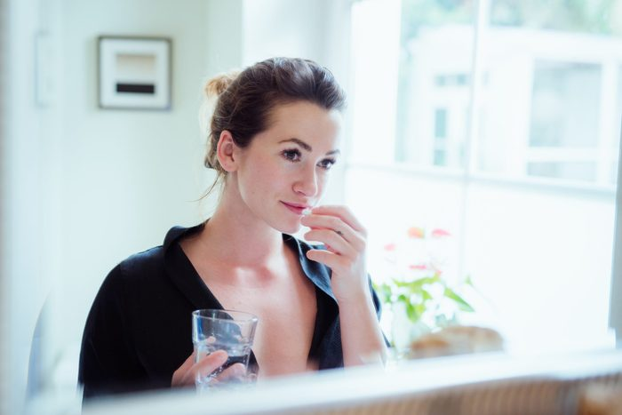 hyaluronic acid supplements | Woman Taking Vitamins And Supplements 2