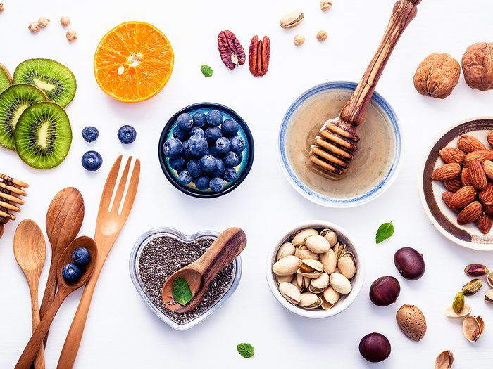 plant-based snacks | Ingredients,for,a,healthy,foods,background,,nuts,,honey,,berries,,fruits,