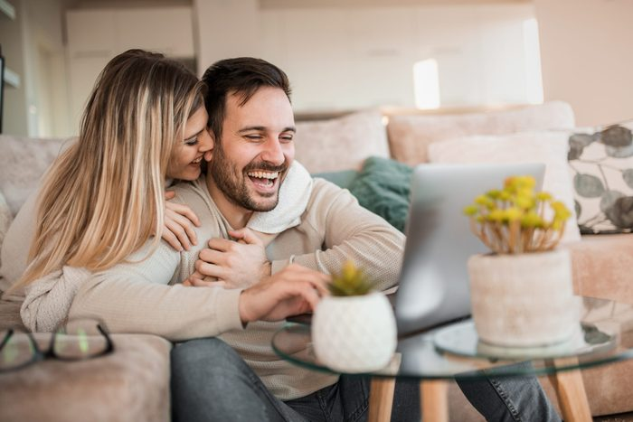 how to spice up your sex life | Young,couple,relaxing,on,sofa,with,laptop.love,happiness,people,and,fun,concept.