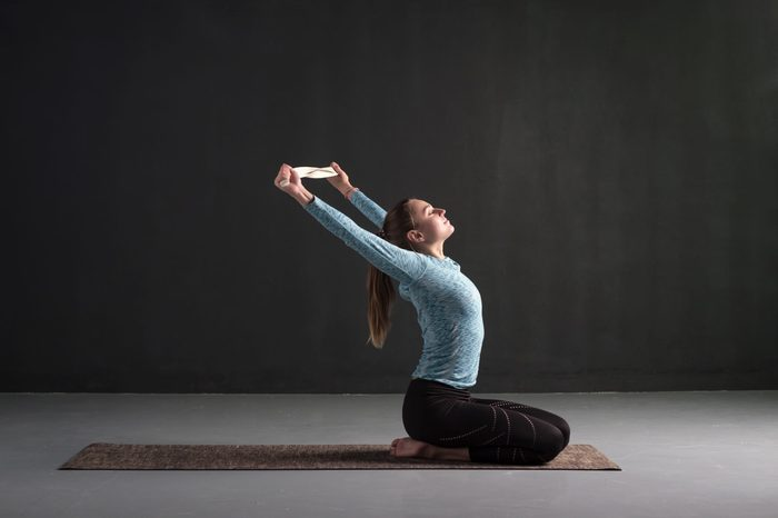 chest stretches | Young,woman,using,strap,or,belt,stretching,opening,her,chest.