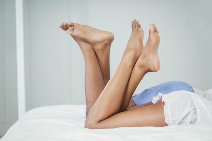 how to spice up your sex life | Side,view,of,couple,on,bed,with,raised,legs,at
