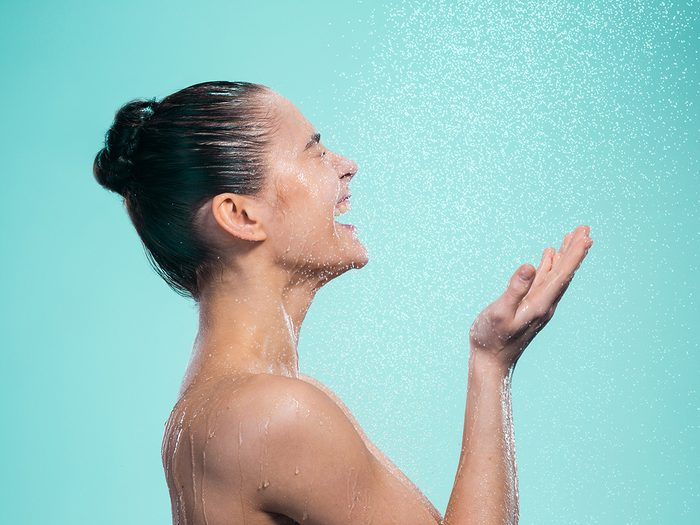 wash face in shower | Woman,enjoying,water,in,the,shower,under,a,shower,jet