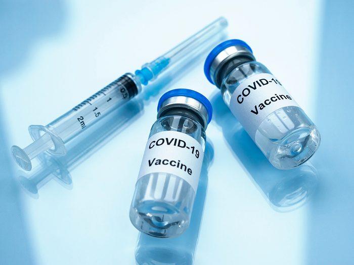 pfizer vs moderna | Two vials of COVID-19 vaccine