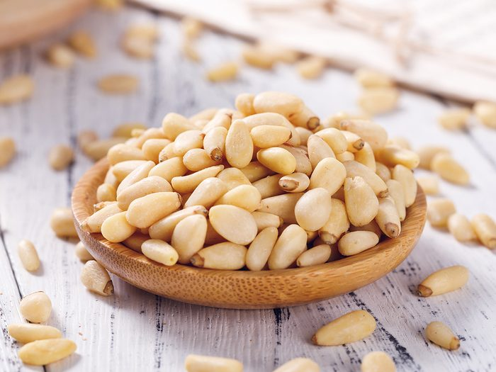 Pine,nuts,on,a,white,board