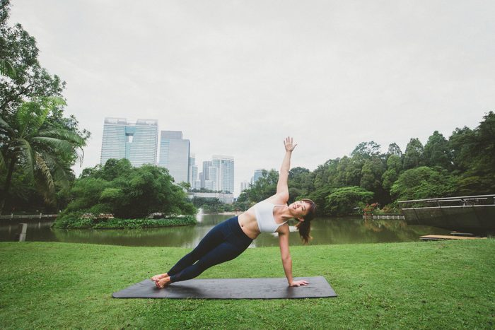 Young Fitness Asian Woman Practicing Yoga Side Plank Pose Together Relax In Nature-scoliosis-stretches