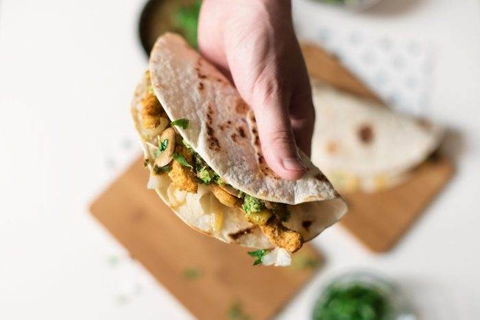 Human Hand Holding Homemade Chicken Taco-are tacos healthy