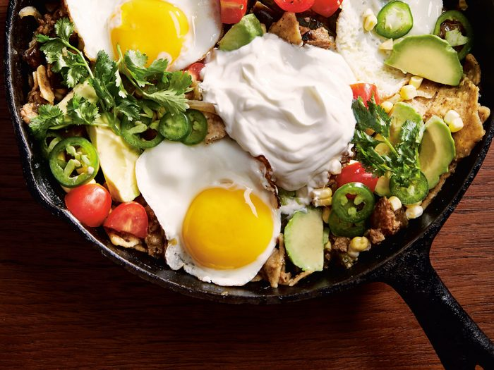 Chilaquiles recipe | image of chilaquiles in a cast iron on a table