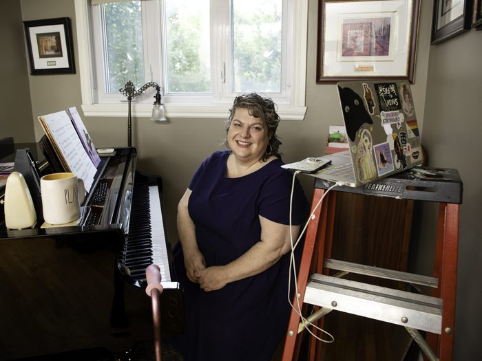 working with a disability | corinna hodgson sitting in her home workspace