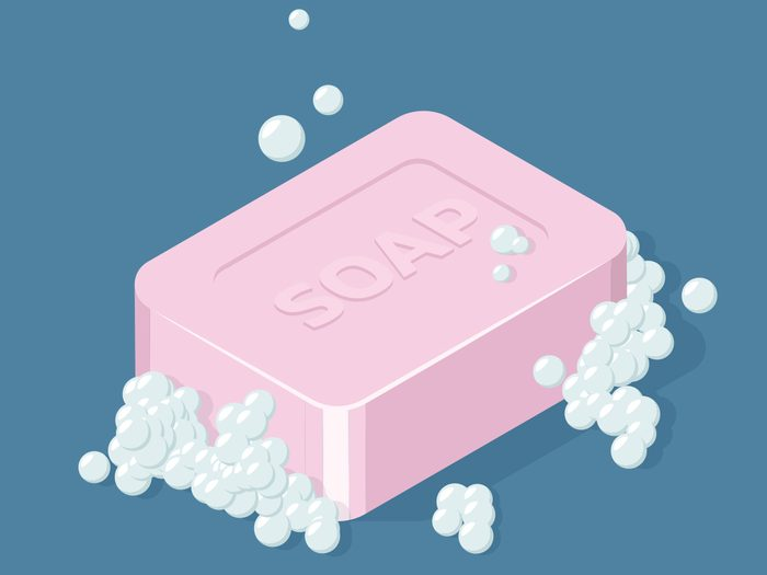 Photo of a pink bar of soap with bubbles on a blue background_Personal Hygiene History Canada Jake Gyllenhaal Ashton Kutcher Mila Kunis Bh Feature